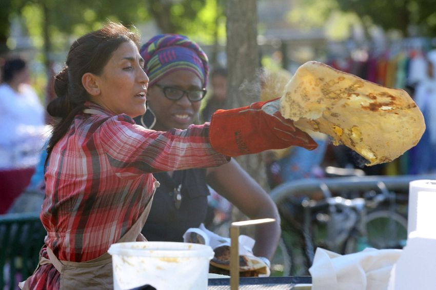 Tandoor flatbread-making at Toronto's RV Burgess Park. Credit: Thorncliffe Park Women's Committee