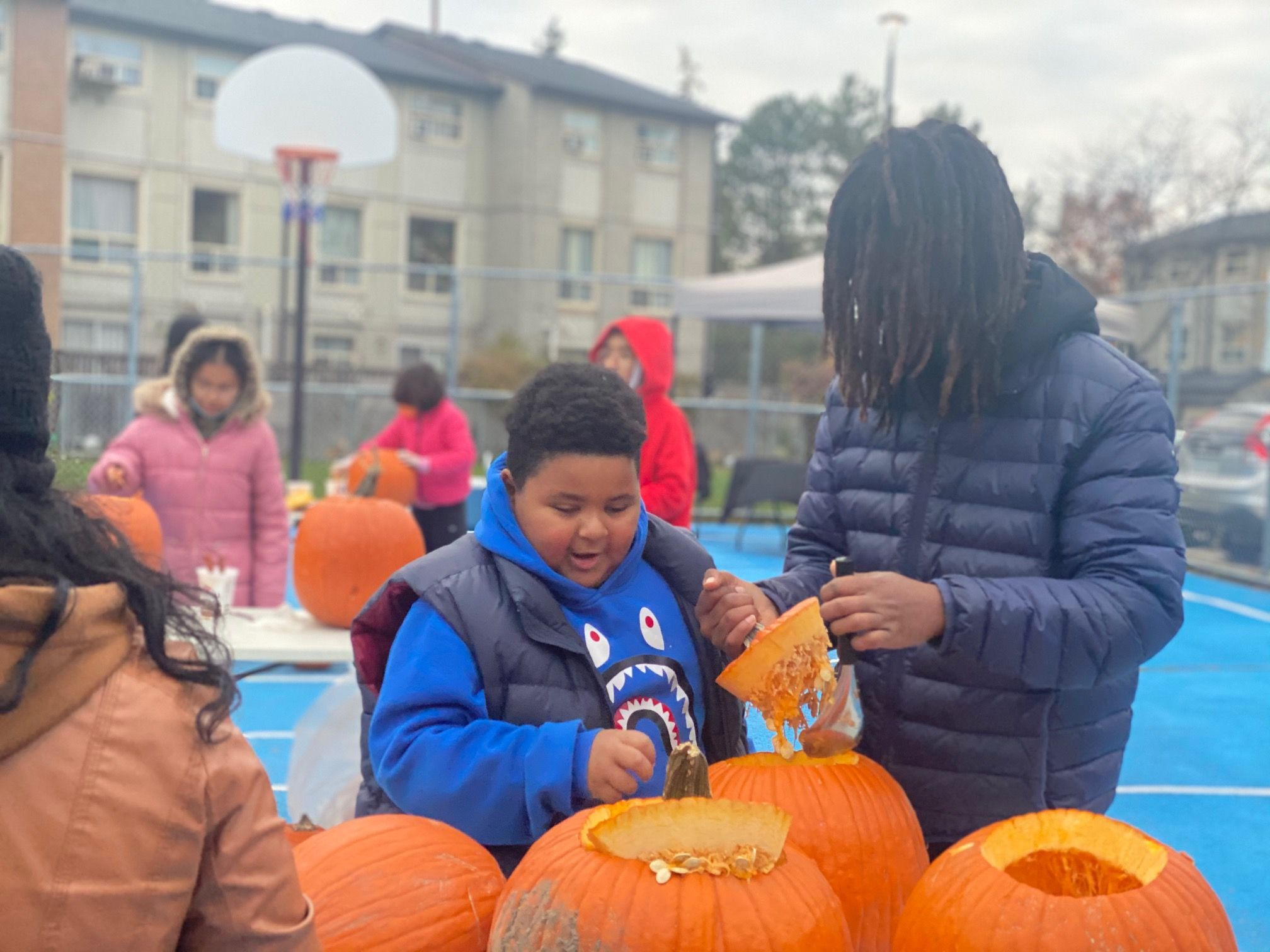 Trying pumpkin carving for the first time at a fall festival organized by Issaq Ahmed.